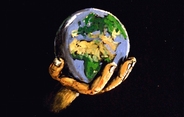 A hand holding the earth