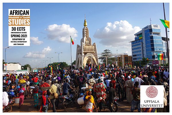 A crowd of people stands in the middle of Independence Square, Bamako, Mali